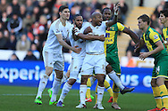 Ashley Williams and Andre Ayew © of Swansea city are held back in the box by Cameron Jerome of Norwich city. Barclays Premier league match, Swansea city v Norwich city at the Liberty Stadium in Swansea, South Wales  on Saturday 5th March 2016.<br /> pic by  Andrew Orchard, Andrew Orchard sports photography.