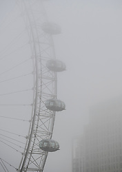 © Licensed to London News Pictures. 22/02/2019. London, UK. Fog shrouds the London Eye on the River Thames in the early morning at Westminster in Central London. Record temperatures for February have been predicted for next week. Photo credit: Ben Cawthra/LNP