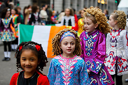 © Licensed to London News Pictures. 15/03/2015. LONDON, UK. Irish dancers parading at St Patrick's Day Parade in central London on Sunday, 15 March 2015. Photo credit : Tolga Akmen/LNP