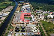 Nederland, Overijssel, Enschede, 30-06-2011; De Grolsch Veste, stadion FC Twente. Het stadion wordt uitgebreid en van een dak voorzien (deze in aanbouw zijnde overkapping is op 8 juli gedeeltelijk ingestort). Industrieterrein De Broeierd, links het Twenthekanaal.FC Twente stadium. The stadium is expanded and provided with a roof..luchtfoto (toeslag), aerial photo (additional fee required).copyright foto/photo Siebe Swart