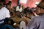 Canadian artist Dave Bidini (right) jams with members of the band King's Jubilee, (from left to right) Zaroe Amilcar, Richard Neufville, Francis Wesseh and Terry Williams at the  Buduburam refugee settlement, roughly 20 km west of Ghana's capital Accra on Friday April 13, 2007. The group, which is composed of five Liberian men living at Buduburam, is currently recording their second album, and already has a growing number of fans back in Liberia. The Buduburam refugee settlement is still home over 30,000 Liberians, most of which have mixed feelings about returning to Liberia..