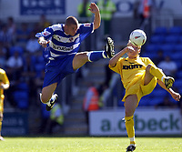 Fotball<br /> 07.08.2004<br /> Foto: SBI/Digitalsport<br /> NORWAY ONLY<br /> <br /> Date: 07/08/2004.<br /> Reading v Brighton and Hove Albion Coca Cola Championship.<br /> <br /> Nicky Forster nicks the ball off Brighton's Dan Harding and carries on to score Reading's third goal.