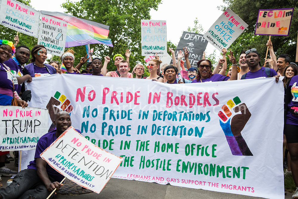 London, UK. 6 July, 2019. Activists from Lesbians and Gays Support The Migrants, African Rainbow Family, the Outside Project, Micro Rainbow and other LGBT+ groups prepare to take part in a London Pride Solidarity March at the very rear of Pride in London - stewards tried to prevent them from joining - in solidarity with those for whom Pride in London is inaccessible and in protest against the corporatisation of Pride in London.