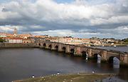 Historic stone bridge crossing River Tweed, Berwick-upon-Tweed, Northumberland, England, UK