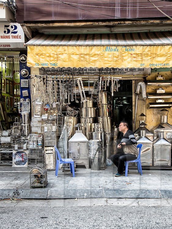 Shop of metal goods along Hang Thiep street known for metal products in Hanoi's Old Quarter, Vietnam, Southeast Asia