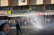 Demonstrators and mourners in the town of Soma, western Turkey as police fire water canon onto the chanting crowds to disperse the people, unprovoked.
