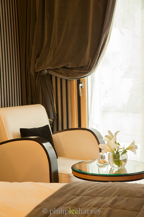 Armchair, table and bed in Hotel and Spa Le Doge interior, Casablanca, Morocco