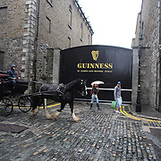 A horse and carriage outside the Guinness Storehouse St. James's Gate Brewery, Dublin, Ireland. Photo Tim Clayton