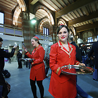 Nederland, Amsterdam , 26 oktober 2011..Feestelijke heropening van de hoofdingang van het Centraal Station..De dames in rode pakjes delen symbolisch dropsleutels uit..Foto:Jean-Pierre Jans