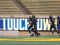 Dec 5, 2020; Berkeley, California, USA; California Golden Bears quarterback Chase Garbers (7) celebrates with teammates after a one yard touchdown against the Oregon Ducks during the first quarter at California Memorial Stadium. Mandatory Credit: Kelley L Cox-USA TODAY Sports