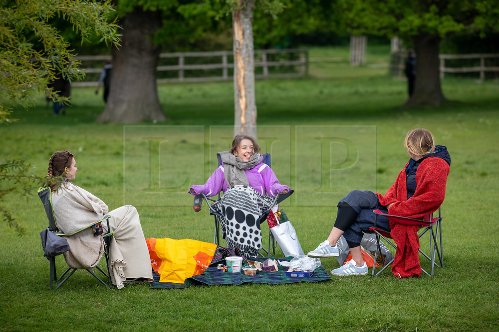 © Licensed to London News Pictures. 13/05/2020. London, UK. Members of the public have a picnic with camp chairs and blankets while social distancing in Richmond Park as the Government relaxes the law on lockdown today to let people spend more time outside to enjoy the fresh air, picnics, sunbathing and meet other people while following social distancing guidelines. Photo credit: Alex Lentati/LNP