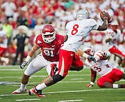 Sep 10, 2011; Little Rock, AR, USA; New Mexico Lobos quarterback Tarean Austin (8) looks to make a pass under pressure from Arkansas Razorback defensive end Jake Bequette (91) during the first half of a game at War Memorial Stadium.  Mandatory Credit: Beth Hall-US PRESSWIRE