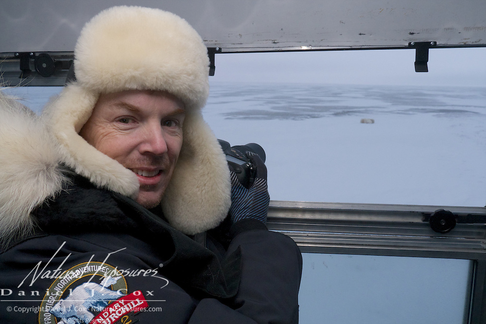 Julius Sughrue photographing polar bears from the Tundra Buggy at Cape Churchill, 2012