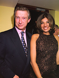 MR BRODERICK MUNRO-WILSON and MRS VIMLA LALVANI, her former husband was a friend of the late Diana, Princess of Wales, at a party in London on 11th November 1997.MDE 25