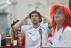 © Licensed to London News Pictures. 07/07/2021. London, UK. England fans react during the game. England fans gather at the Fan Zone in Trafalgar Square, central London, for the Euro 2020 semi final between England and Denmark. England are attempting to reach their first final since 1966. Photo credit: Ben Cawthra/LNP