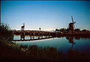 Kinderdijk windmills at full moon night. UNECSCO heritage site. © Holland Kodak Ektar serie