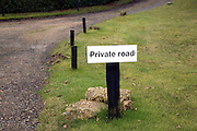 Private road sign on grass verge