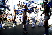 Dancers from one of the collectivities that dispute Mindelos Carnival prize performing during the parade in Lisboa street on Carnival Tuesday.