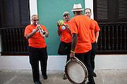 Band members relax before performing during the Festival of San Sebastian in San Juan, Puerto Rico.