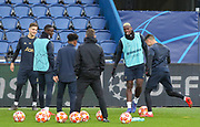 Manchester United Midfielder Paul Pogba Manchester United Defender Diogo Dalot and Manchester United Defender Eric Bailly in warm up during the Manchester United Training session ahead of the Paris Saint-Germain vs Manchester United Champions League match at Parc des Princes, Paris, France on 5 March 2019.