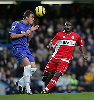 Photo: Lee Earle.<br /> Chelsea v Middlesbrough. The Barclays Premiership.<br /> 03/12/2005. Chelsea's John Terry (L) clears from the approaching Yakubu.