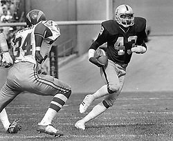 Raiders George Atkinson with interception against the San Diego Chargers , Rickey Young..(1977 photo/Ron Riesterer)