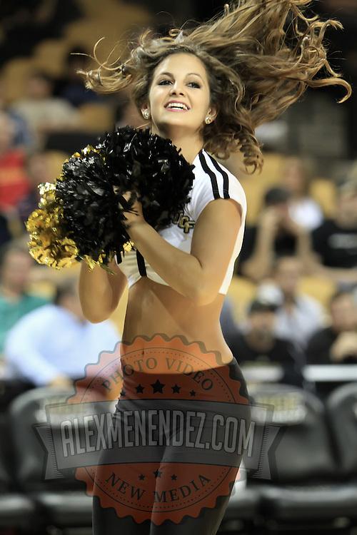 A team dancer performs at the University of Central Florida Knights mens basketball game against the West Florida Argonauts in the first home game of the 2010 season at the UCF Arena on November 12, 2010 in Orlando, Florida. UCF won the game 115-61. (AP Photo/Alex Menendez)