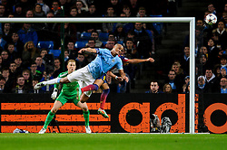 Man City Defender Vincent Kompany (BEL) and Barcelona Forward Alexis Sanchez (CHI) compete in the air in front of goal - Photo mandatory by-line: Rogan Thomson/JMP - Tel: 07966 386802 - 18/02/2014 - SPORT - FOOTBALL - Etihad Stadium, Manchester - Manchester City v Barcelona - UEFA Champions League, Round of 16, First leg.