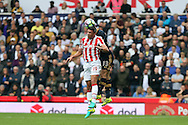 Jonathan Walters of Stoke City heads the ball ahead of Ben Davies of Tottenham Hotspur. Premier league match, Stoke City v Tottenham Hotspur at the Bet365 Stadium in Stoke on Trent, Staffs on Saturday 10th September 2016.<br /> pic by Chris Stading, Andrew Orchard sports photography.