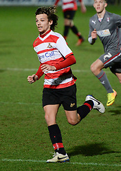 © London News Pictures. 26/02/2014. Doncaster, UK. One Directions Louis Tomlinson makes his debut for Doncaster reserves against Rotherham at the Keepmoat Stadium in Doncaster 26 February 2014 . Photo credit: London News Pictures.