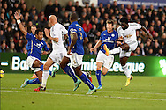 Wilfried Bony of Swansea city ® hits a shot just wide of goal. Barclays Premier league match, Swansea city v Leicester city at the Liberty stadium in Swansea, South Wales on Saturday 25th October 2014<br /> pic by Andrew Orchard, Andrew Orchard sports photography.