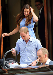 The Duke and Duchess of Cambridge leave St. Mary's hospital in London with their  new baby boy in a baby carrier  Tuesday, 23rd July 2013<br /> Picture by Stephen Lock / i-Images