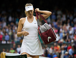 28.06.2014, All England Lawn Tennis Club, London, ENG, WTA Tour, Wimbledon, im Bild Maria Sharapova (RUS) collects her Head bag after winning the Ladies' Singles 3rd Round match 6-3, 6-0 on day six // 15065000 during the Wimbledon Championships at the All England Lawn Tennis Club in London, Great Britain on 2014/06/28. EXPA Pictures © 2014, PhotoCredit: EXPA/ Propagandaphoto/ David Rawcliffe<br /> <br /> *****ATTENTION - OUT of ENG, GBR*****