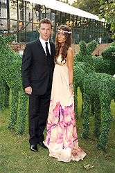 NICK CANDY and YAEL TORM-HIBLER at the Royal Parks Foundation Summer Party hosted by Candy & Candy on the banks of the Serpentine, Hyde Park, London on 10th September 2008.