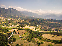 Aerial view of rolling hills, mountains and country lanes in Avellino Province, Campania, Southern Italy.