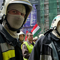 Protesting firemen attend an anti-government rally in Budapest, Hungary on April 16, 2011..Thousands of Hungarians, including policemen and firefighters, on Saturday protested against the government's austerity measures. The government has launched a package of fiscal reforms to cut the budget deficit, including scrapping early retirement, which mostly affects law enforcement personnel.