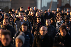 © Licensed to London News Pictures. 11/02/2020. London, UK. Commuters cross London Bridge during a clear, cold sunrise in the capital this morning, following days of disruption caused by Storm Ciara. The following storm - Storm Dennis - is due to hit the UK in the coming days. Photo credit : Tom Nicholson/LNP