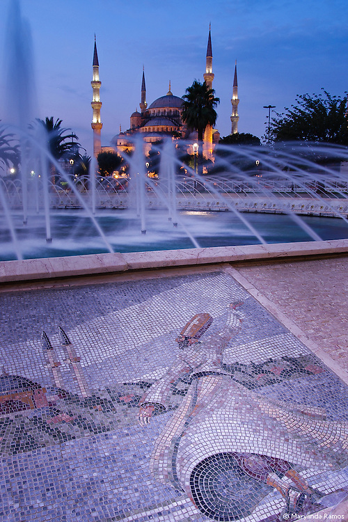 In the early morning light, a mosaic depicting a whirling dervish with one hand to heaven and the other to earth.  The hand held to heaven shows the direction to the Blue Mosque.