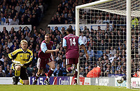 Manchester City v West Ham United, FA Barclaycard Premiership, Maine Road, Manchester. 27/04/2003.<br />West Ham's Don Hutchison (C) celebrates as Man City goalkeeper Peter Schmeichel cannot hide his disappointment as West Ham scramble a goal.<br /> Photo: Jed Wee, Digitalsport