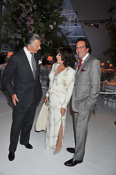 Left to right, ARNAUD BAMBERGER, JOAN COLLINS and PERCY GIBSON at a dinner hosted by Cartier following the following the opening of the Chelsea Flower Show 2012 held at Battersea Power Station, London on 21st May 2012.