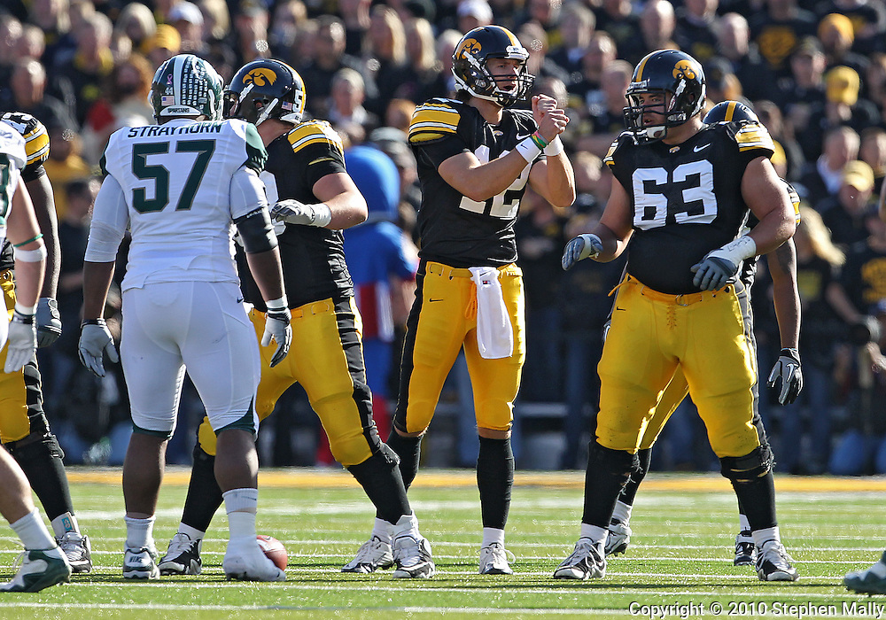 October 30 2010: Iowa Hawkeyes quarterback Ricky Stanzi (12) signals his team during the first quarter of the NCAA football game between the Michigan State Spartans and the Iowa Hawkeyes at Kinnick Stadium in Iowa City, Iowa on Saturday October 30, 2010. Iowa defeated Michigan State 37-6.