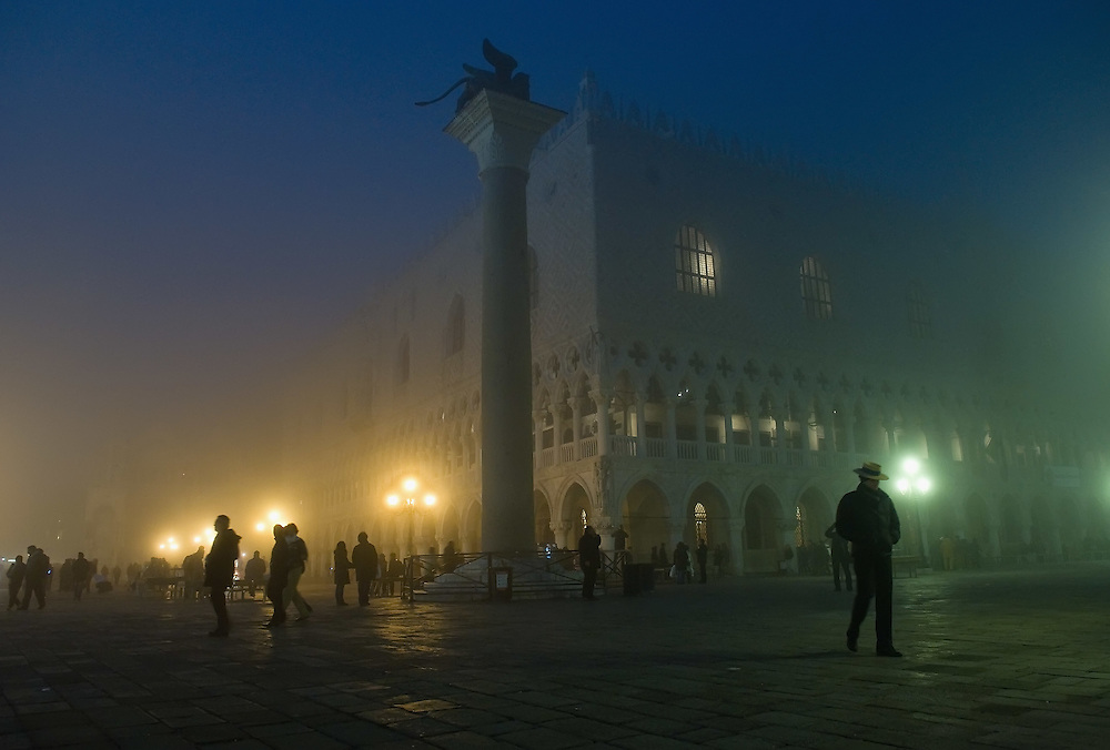 VENICE, ITALY - NOVEMBER 20:  A gondolier walks in St Mark's Square as thick fog shrouds the city, on November 20, 2011 in Venice, Italy. Venice woke up this morning under a heavy blanket of fog adding to the atmosphere of the city. <br /> <br /> HOW TO LICENCE THIS PICTURE: please contact us via e-mail at sales@xianpix.com or call our offices London   +44 (0)207 1939846 for prices and terms of copyright. First Use Only ,Editorial Use Only, All repros payable, No Archiving.© MARCO SECCHI