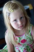 Unhappy young Polish girl age 4 looking sad. Zawady Central Poland