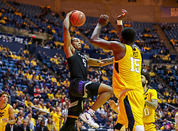 Feb 18, 2019; Morgantown, WV, USA; Kansas State Wildcats guard Barry Brown Jr. (5) attempts to dunk during the first half against the West Virginia Mountaineers at WVU Coliseum. Mandatory Credit: Ben Queen-USA TODAY Sports