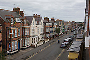 Aerial view of a person carrying items across Marshall Street, on 14th July 2017, at Bridlington, East Riding, England.