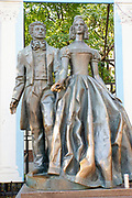 Bronze statue of Alexander Pushkin and Natalya Goncharova by Alexander Bourganov Old Arbat street Moscow Russia