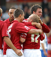 Photo: Dave Linney.<br />Walsall v Hartlepool United. Coca Cola League 2. 12/08/2006Walsall goalscorer.Dean Keats(C) is mobbed by his team mates after he made it 1-0 to the saddlers