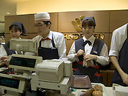 ringing up customers in a Japanese store