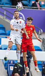 CARDIFF, WALES - Saturday, June 5, 2021: Albania's Endri Çekiçi (L) challenges for a header with Wales' Neco Williams during an International Friendly between Wales and Albania at the Cardiff City Stadium in their game before the UEFA Euro 2020 tournament. (Pic by David Rawcliffe/Propaganda)