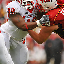 Sep 26, 2009; College Park, MD, USA; Rutgers defensive tackle Blair Bines (48) battles Maryland offensive lineman Bennett Fulper (63) during the first half of Rutgers' 34-13 victory over Maryland in NCAA college football at Byrd Stadium.